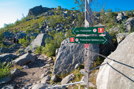 directional sign to the famous preikestolen. Preikestolen or Prekestolen (English: The Pulpit Rock, Pulpit or Preacher's Chair) is a tourist attraction in the municipality of Forsand in Rogaland county, Norway. Editorial