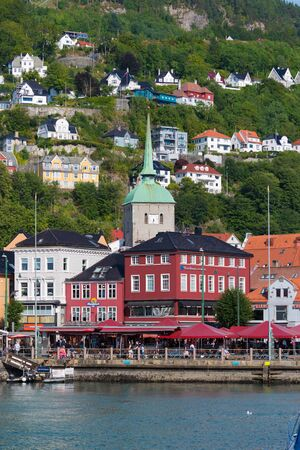 view on a part of the historical center of Bergen, Norway, with in the middle the Kors church (Korskirken). Banco de Imagens