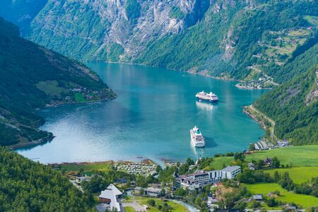 Beautiful view on Geiranger fjord with two cruise ships moored