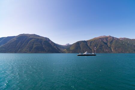 beautiful view over the Sognefjord in Norway with a ferry boat in the background