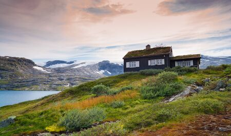 typical norwegian house in a beautiful natural surrounding