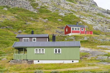 typical norewegian houses in a rocky mountain landscape Banco de Imagens