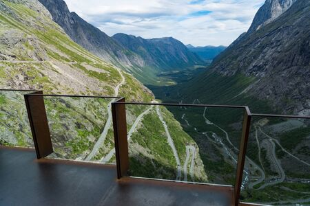Unique viewpoint platform looking out over the Trollstigen or Trolls Path, a serpentine mountain road in Rauma Municipality