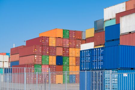 lots of piled up containers at a container terminal in the netherlands