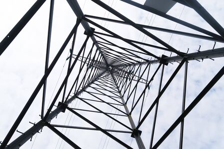 high voltage electricity pylon seen from below
