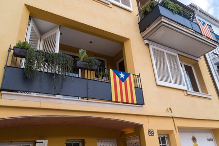 facades and houses in cataluna, spain, decorated with independence flags and yellow ribbons