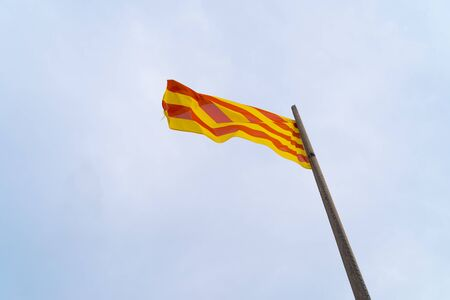 waving Catalan flag during the 2019 independence demonstrations