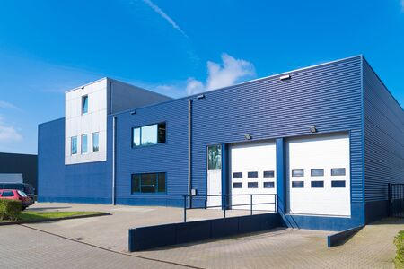 exterior of a modern warehouse with a small office unit Archivio Fotografico