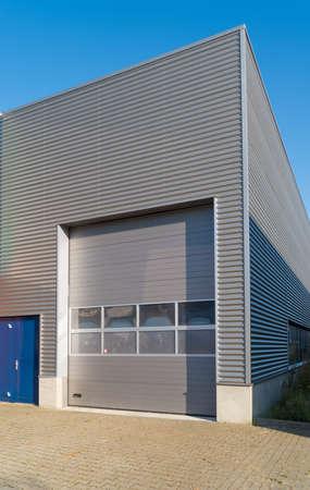 modern industrial unit with roller doors Stockfoto