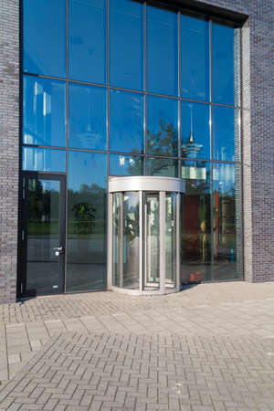 glass entrance of a modern office building