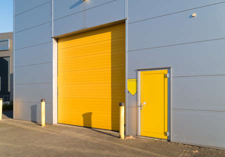 small industrial unit with yellow roller doors