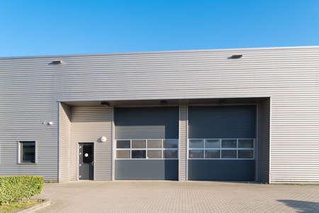 industrial unit with roller doors Archivio Fotografico