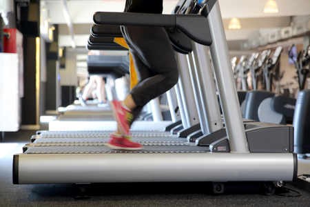 Training on the treadmill in the gym