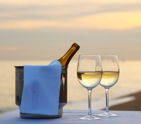 beach drink: A restaurant table on a beach Stock Photo