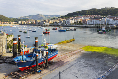 castro: A fishing boat being repaired at the Castro Urdiales harbour, Spain Stock Photo