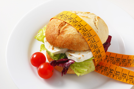 cordon tape: A delicious bun filled with mixed salad and goat cheese with sesame seeds.