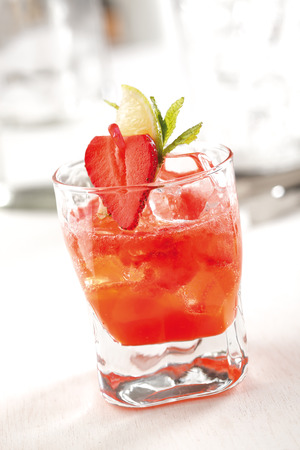 cocktail glasses: Stock photo of a strawberry mojito cocktail, prepared with rum, strawberries, mint leaves, lime juice and soda.