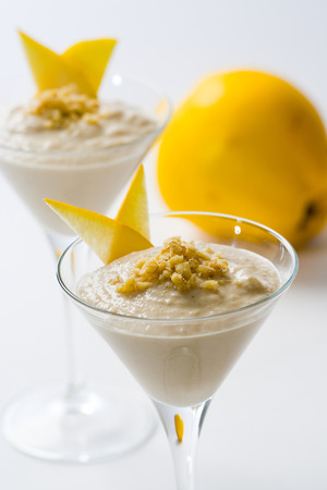 ground nuts: A delicious quince smoothie topped with ground nuts.