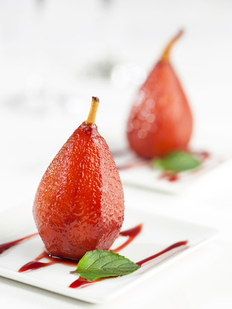 wine stocks: A dessert of sweet pears cooked in red wine