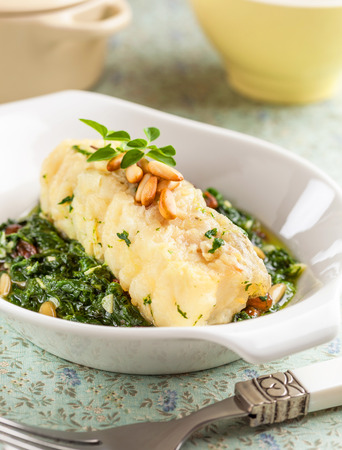 bacalao: Cod prepared with spinach and pine seeds