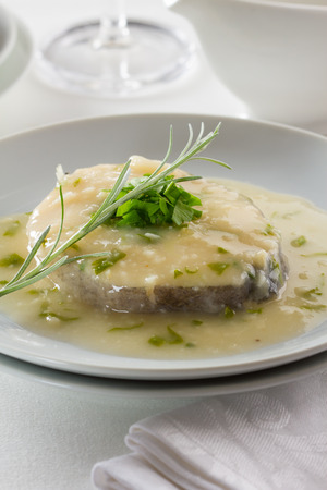 hake: Hake in a cream sauce with parsley