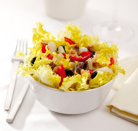 endive: A Mediterranean endive salad called xato, with cod, tuna, anchovies and olives.