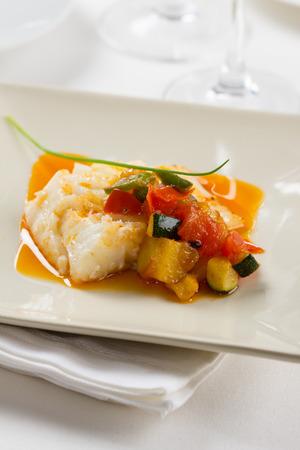 potato cod: Cod prepared with tomato, courgette and potato.