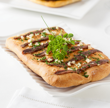 mediterranean countries: Coca with anchovies. Coca is a typical pastry from the Catalan region of Spain. Similar preparations can be found in other Mediterranean countries.