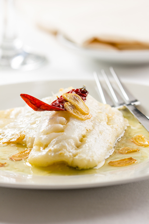 cod oil: Basque style cod dish with chili pepper, garlic and olive oil Stock Photo