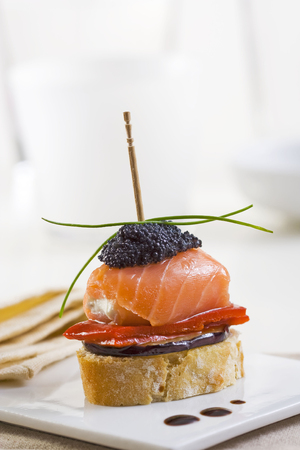 Spanish montadito tapa with salmon and caviar