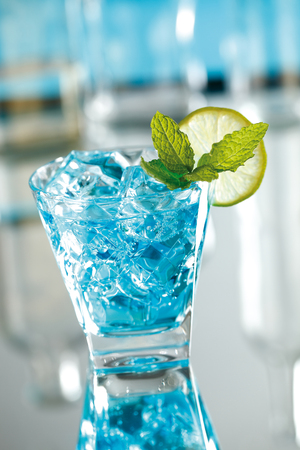 curacao: Blue mojito cocktail made with sugar, lime juice, mint leaves, soda, white rum and blue curacao.