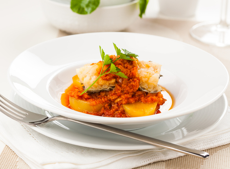 A dish of ajo colorao with bacalao, a typical Spanish dish from the region of Andalucia, especially the towns of Almería, Córdoba and Málaga