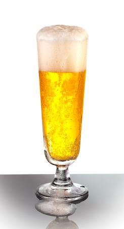 pilsner beer glass: An overflowing glass of refreshing pilsner beer