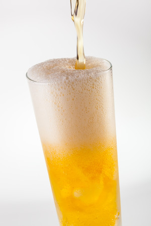 pilsner glass: Pouring refreshing Pilsner beer in a glass Stock Photo