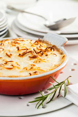 white backing: A dish of moussaka, a typical Greek dish, prepared with, eggplant, meat and cheese