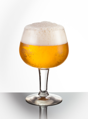 unbottled: An ice cold snifter glass of refreshing beer Stock Photo
