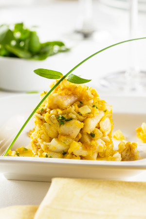 bacalao: Cocochas (in basque kokotxas) refer to the flesh under a fishs jaw. Due to their high gelatinous content they make a fantastic broth. They are usually prepared with olive oil, garlic, and parsley. Stock Photo