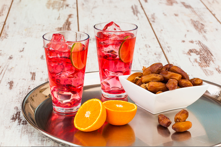 break fast: Cold refreshing syrup drink, sweet dates and fruit for iftar break fast during fasting month of Ramadan.