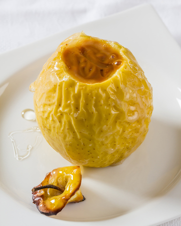 speciality: Oven baked apple filled with dulce de leche, a speciality from Argentina. Stock Photo