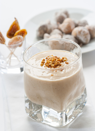ground nuts: A delicious dried fig smoothie topped with ground nuts.