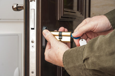 lock: Locksmith replacing a cylinder lock