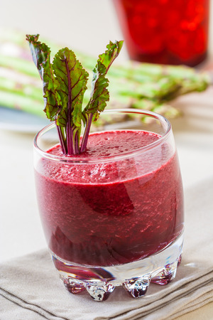 Fresh beet juice with leaves in a glass