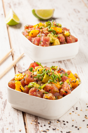 Hawaiian tuna poke with mango, avocado, onion and sesame seeds.