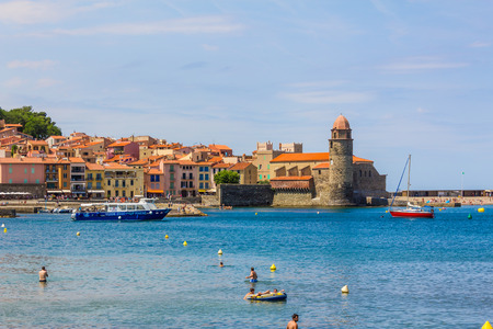 vermilion coast: COLLIOURE, FRANCE -  JUNE 26: Tourists enjoy the beach of Collioure, coastal village in the south of France, Mediterranean sea, Languedoc Roussillon, Pyrenees Orientales