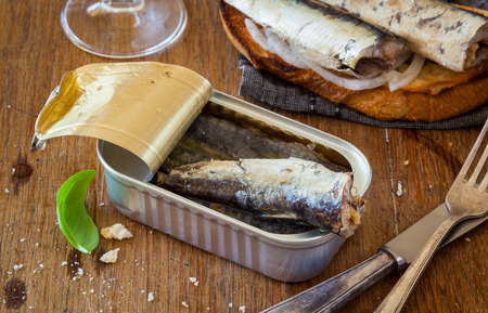 sardine can: Toast with sardines, olives and white wine served as appetizer or tapa Stock Photo