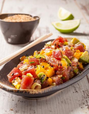 Hawaiian tuna poke with mango, avocado, onion and sesame seeds.