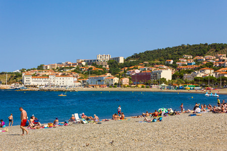 vermilion coast: BANYULS-SUR-MER, FRANCE - JUNE 26: Tourists on the beach of Banyuls-sur-Mer, coastal town in the south of France, Mediterranean sea, Roussillon, Pyrenees Orientales, Vermilion coast, France