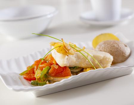 Grouper fillet served with fried garlic an vegetables.