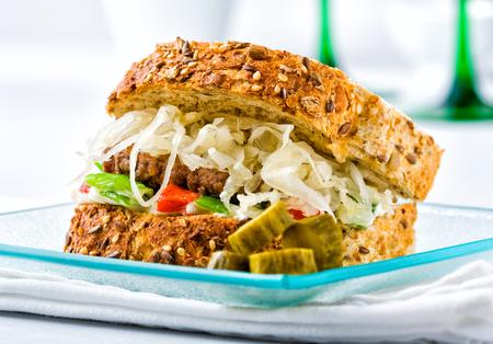 A luxury hamburger with artisan bread and sauerkraut.