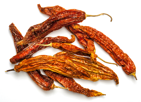 Aji amarillo, dry pepper from the Peruvian cuisine. Isolated on white. Stock Photo
